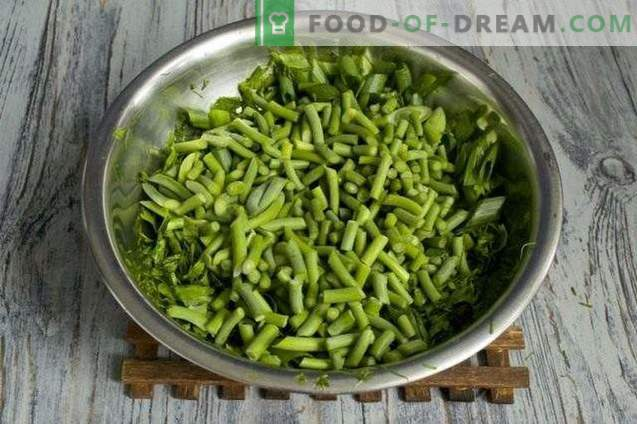 Preparation of greens for the winter: seasoning for salads and soups with garlic, ...