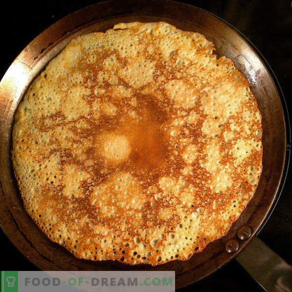 Pâte savoureuse pour les crêpes, brassée sur de l'eau minérale
