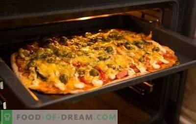 La recette de la pizza au four est un plat préféré de la maison. Recettes de pizza au four: avec du fromage, des champignons, du jambon, des fruits de mer