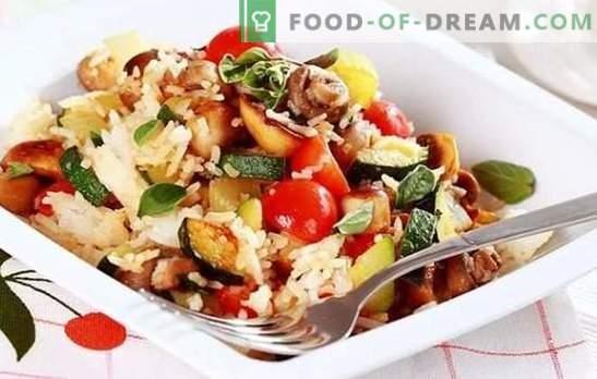 Risotto aux légumes - cuisine européenne traditionnelle. Risotto luxueux aux légumes: classique, champignon et diététique